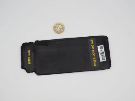 Number Plate GPS Tracker with pound coin for size comparison